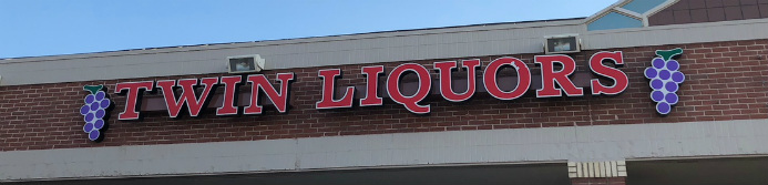 twin liquors store sign